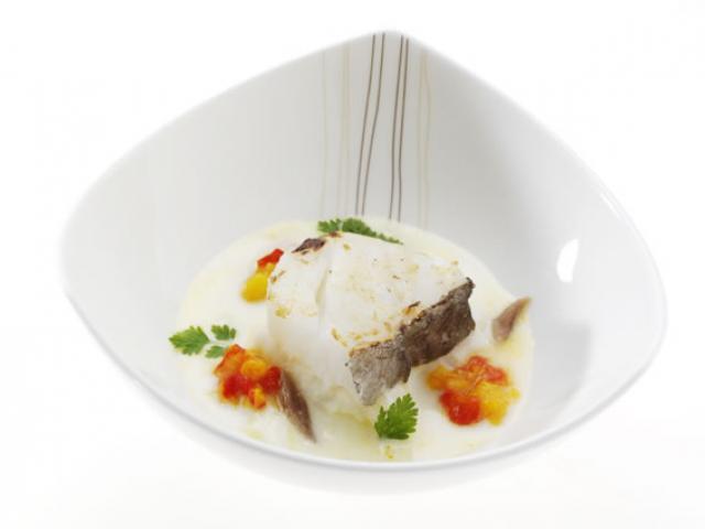 Baccalà servito nella sua crema di aglio dolce