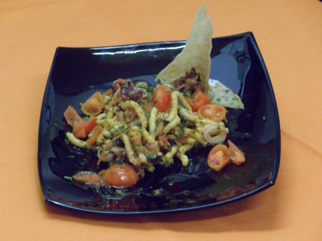Passatelli con calamari, strigoli e pomodorini pachino