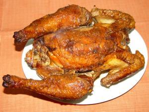 Pollo ripieno e cotto al forno a legna